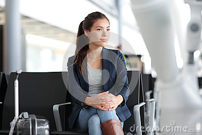 Airport woman waiting in terminal - air travel