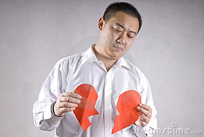 Aisa man with broken heart