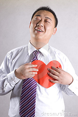 Aisa man with red heart