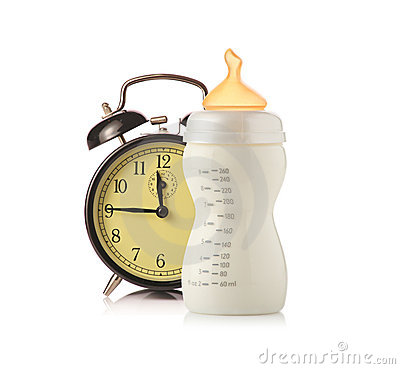 Alarm clock and baby feeding bottle with milk