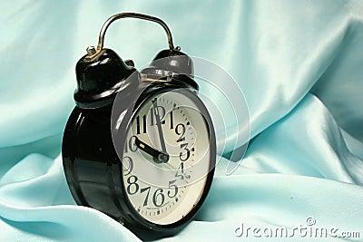 Alarm-clock on blue background