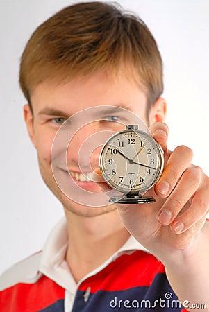 Alarm clock in hands
