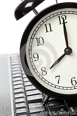 Alarm clock and laptop