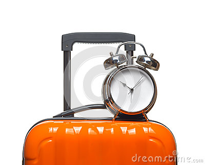 Alarm clock on orange suitcase