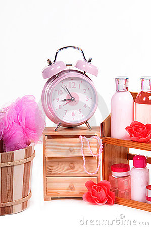 Alarm clock and pink body care accessories