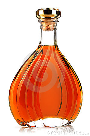 Alcohol cognac in a closed bottle on white