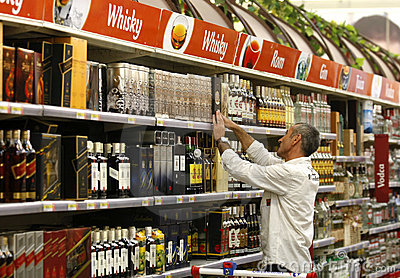 Alcohol and liqour shopping at supermarket Editorial Stock Image