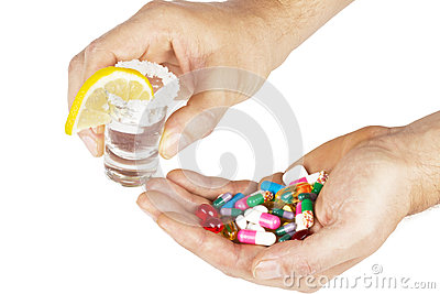 Alcohol with medicines with hands on white