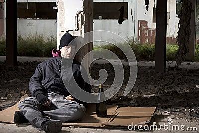 Alcoholic Sitting on the Floor