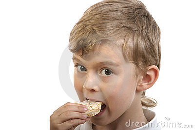 Alergic boy having corn bread