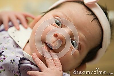Alert infant baby girl