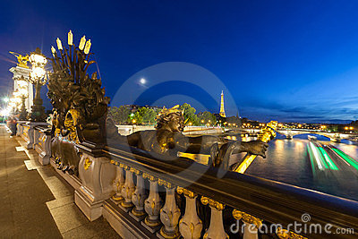 Alexander III bridge at night and Seine with boat Editorial Stock Image