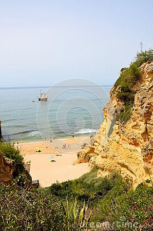Algarve beach and a portuguese caravel