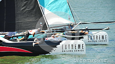 Alinghi racing GAC Pindar at Extreme Sailing Series Singapore 2013 Editorial Stock Image