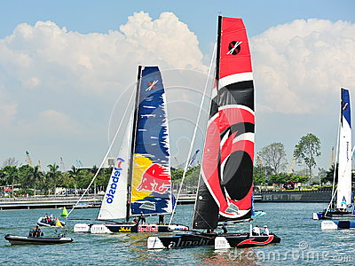 Alinghi racing Red Bull Sailing Team at Extreme Sailing Series Singapore 2013 Editorial Stock Photo