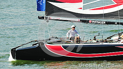 Alinghi skipper steering boat at Extreme Sailing Series Singapore 2013 Editorial Stock Image