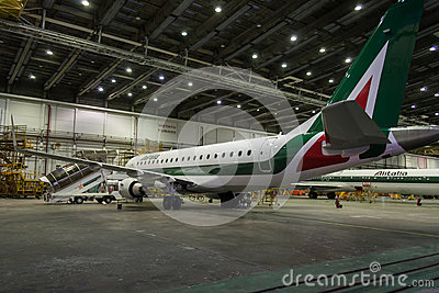 Alitalia Embraer in Hangar by night Editorial Photography