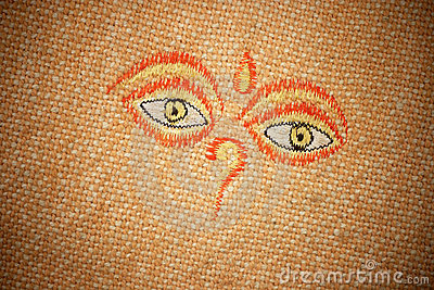 The all-seeing eyes of Buddha on canvas texture.