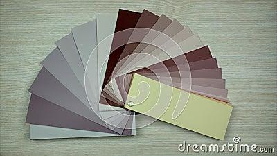 Alla färger i färgprovkartor bokar Isolerat p? tr?bakgrund Val av färg i inredesign Stoppa r?relse arkivfilmer