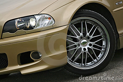 Alloy wheel on golden sports car