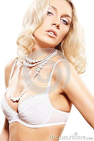 Alluring blond model in lingerie. Wedding night