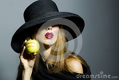 Alluring blonde girl with apple Stock Photo