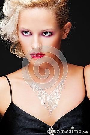Alluring blonde over black background
