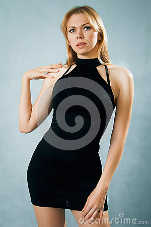 Alluring blonde woman in black dress