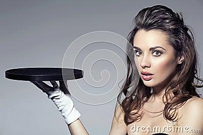 Beauty brunette holding a tray
