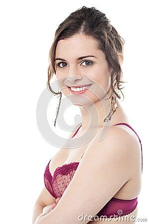 Alluring female model in pink brassiere