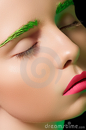 Alluring model with creative make-up, pink lips