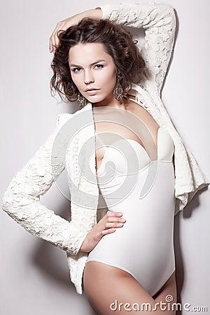Alluring Shiny Supermodel Female posing in White Retro Underwear