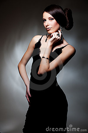 Alluring woman in black dress