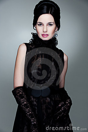 Alluring woman in black dress and gloves