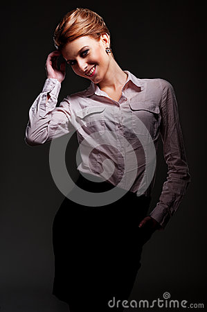 Alluring woman posing over dark background