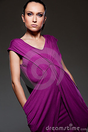 Alluring woman in violet dress