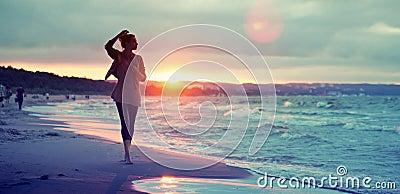 Alluring woman walking along the seaside