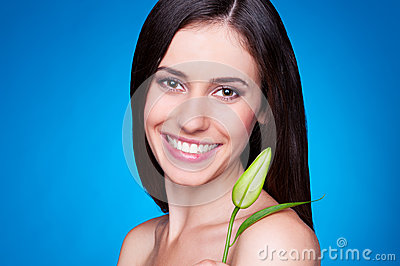 Alluring young female with flower bud