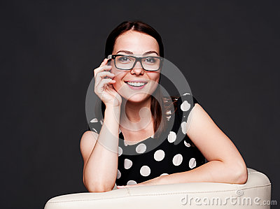 Alluring young woman in glasses