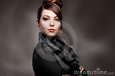 Alluring young woman over dark background