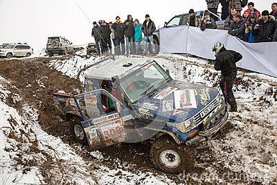 Almaty, Kazakhstan - February 21, 2013. Off-road racing on jeeps, Car competition,  ATV. Traditional race Editorial Image