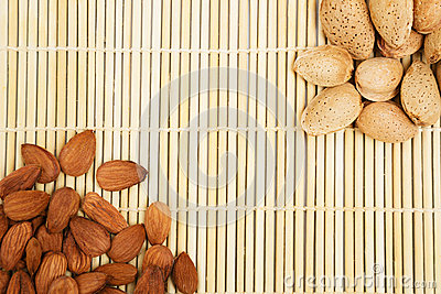 Almonds in a background tablecloth, snacks of nuts