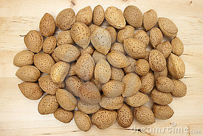 Almonds group on a wooden background