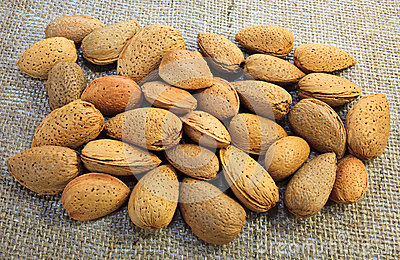 Almonds on jute surface