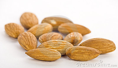 Almonds in pile on white background