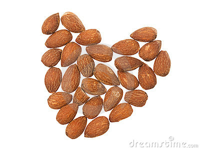 Almonds in shape of heart on white background