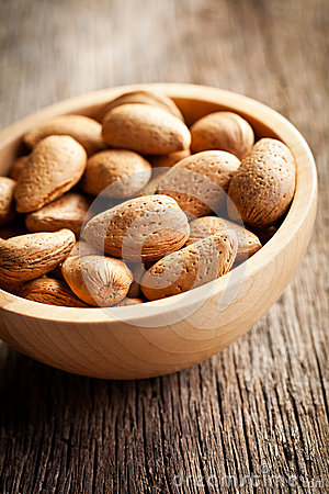 Almonds in wooden bowl