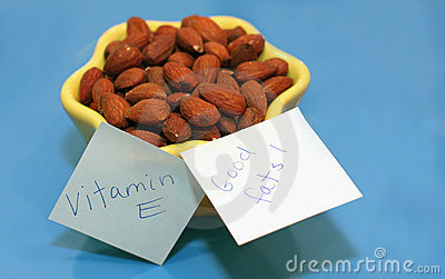Almonds in yellow dish and blue background