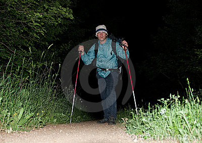 Alone backpacker hikes at night
