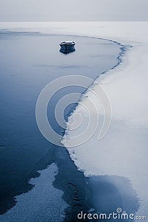 Alone boat on frozen river